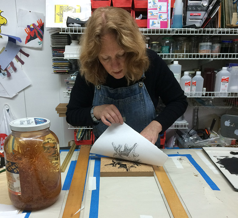 Kathy Strauss pulling a print